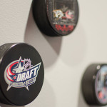 hockey pucks on wall