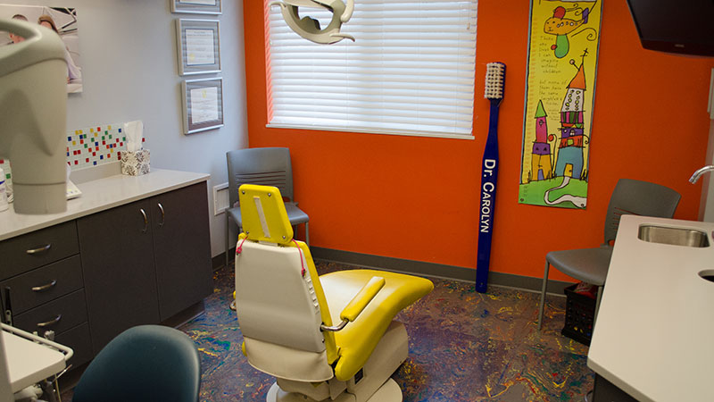Image Of Pediatric Dental Room With Orange Walls And Yellow Dentist Chair