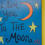 image of picture on wall reading I love you to the moon